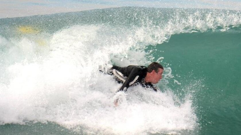 Professional body boarder Jeff Oglesby rides a wave in one of the first prototypes of Wave Wrecker.