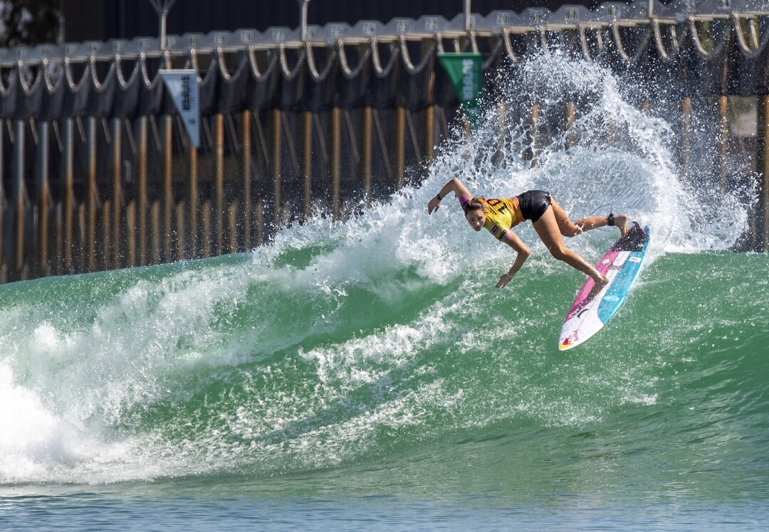 Four-time world champion Carissa Moore does a slashing turn.