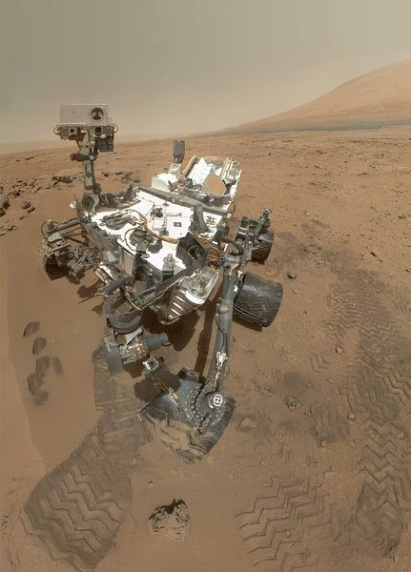 Curiosity rover gulps Mars air, finds hint of vanished atmosphere