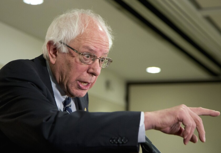 Democratic presidential candidate Sen. Bernie Sanders of Vermont speaks to reporters and members of the Communication Workers of America following the union's endorsement of him Thursday in Washington, D.C.