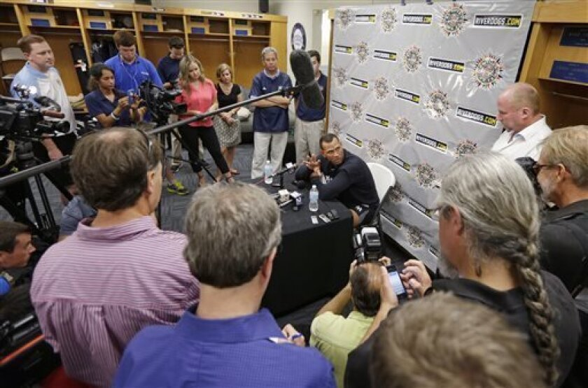 New York Yankees third baseman Alex Rodriguez, center, speaks during a news conference before playing in his first rehab game with the Charleston RiverDogs in Charleston, S.C., Tuesday, July 2, 2013. (AP Photo/Chuck Burton)