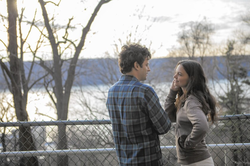 "Luke Kirby and Katie Holmes in ""Touched With Fire."""