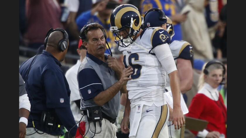 Rams Coach Jeff Fisher checks quarterback Jared Goff, who had just run for a touchdown in the fourth quarter.