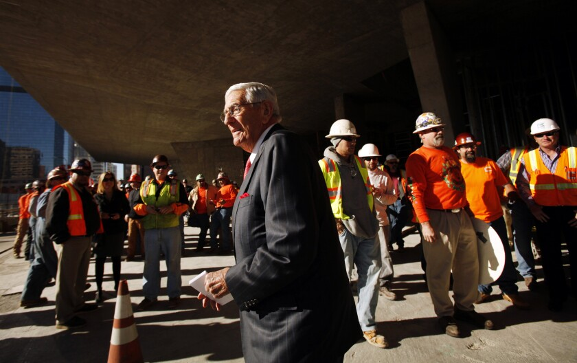 Eli Broad surrounded by construction workers outside the Broad museum