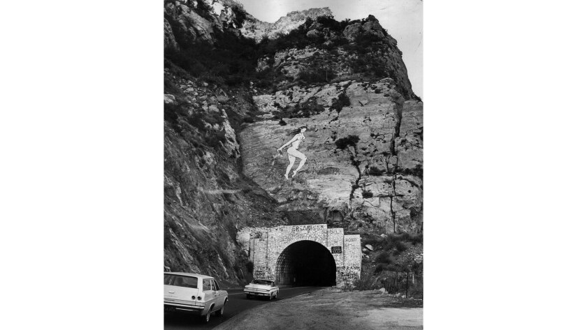Oct. 31, 1966: Figure of a nude that has appeared above tunnel on Malibu Canyon Road. The painting b