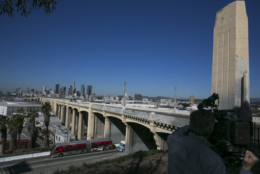 In this Wednesday, Feb. 3, 2016, photo The 6th Street Bridge that spans the Los Angeles River is seen in Los Angeles, before it is closed permanently for demolition. The landmark bridge, dating to the 1930's, is being replaced due to deterioration caused by a chemical reaction in the concrete. The