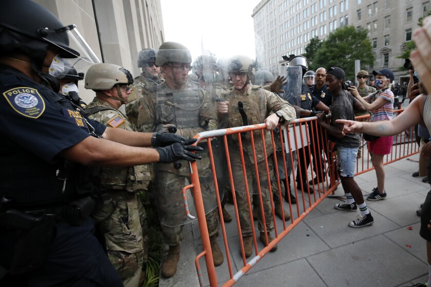 National Guard soldiers and Department of Homeland Security Police secure a fence barricade as demonstrators gather to protest the death of George Floyd, Wednesday, June 3, 2020, near the White House in Washington. Floyd died after being restrained by Minneapolis police officers. (AP Photo/Alex Brandon)