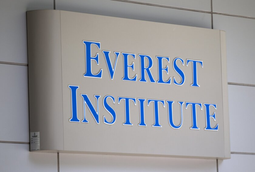 An Everest Institute sign is seen in an office building in Silver Spring, Md., in 2014. The federal government will erase portions of the debt of some of the students who attended the now-defunct Corinthian Colleges.