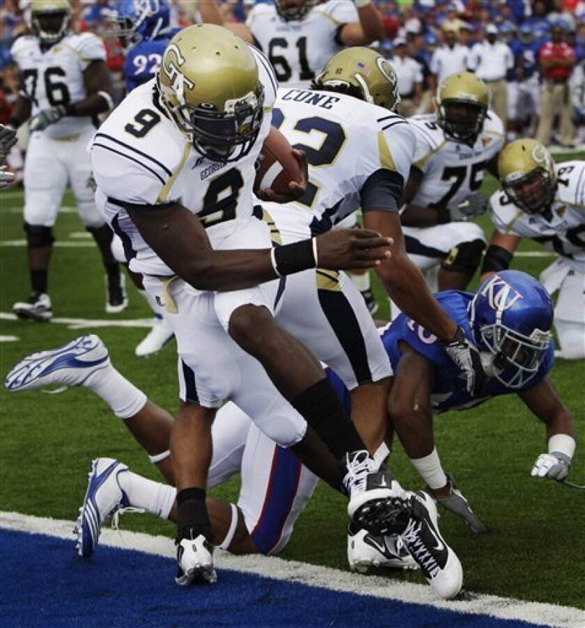 Georgia Tech Yellow Jackets quarterback Joshua Nesbitt (9) crosses the goal line for a touchdown during the first half of an NCAA college football game against Kansas in Lawrence, Kan., Saturday, Sept. 11, 2010. (AP Photo/Orlin Wagner)
