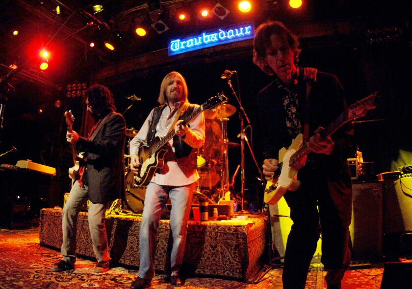 Mike Campbell, left, Tom Petty and Tom Leadon of Mudcrutch perform at the Troubadour on May 1, 2008, in West Hollywood.