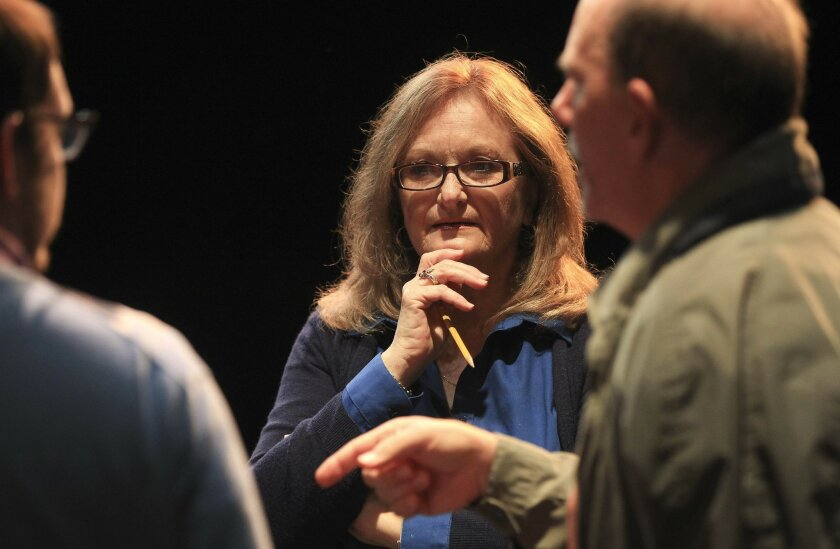 "Kathy Brombacher discusses lines with actors Ryan Hunter Lee (playing Barry) and Jim Winkler (Mr. Klemper) in the play ""The Boys Next Door."""