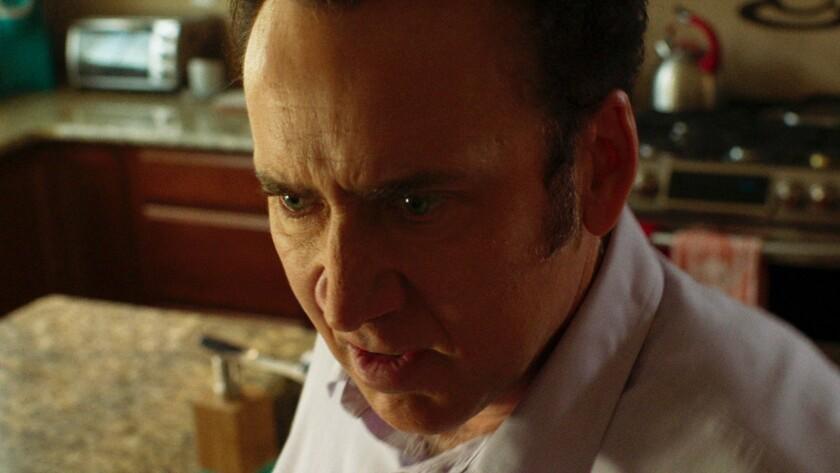 "Nicolas Cage in the movie ""Mom and Dad."""
