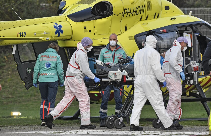 A COVID-19 patient from the Netherlands arrives for treatment by helicopter