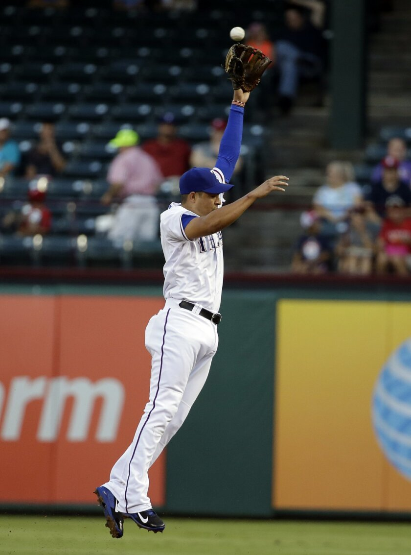 Texas Rangers second baseman Guilder Rodriguez leaps but is unable to grab a single to right by Los Angeles Angels' Howie Kendrick in the first inning of a baseball game, Tuesday, Sept. 9, 2014, in Arlington, Texas. Rodriguez made his major league debut in the game. (AP Photo/Tony Gutierrez)