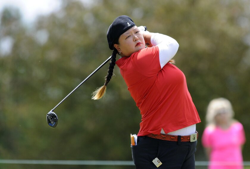 Christina Kim hits from the second tee during the final round of the LPGA Volvik Championship golf tournament at the Travis Pointe Country Club, Sunday, May 29, 2016 in Ann Arbor, Mich. (AP Photo/Jose Juarez)