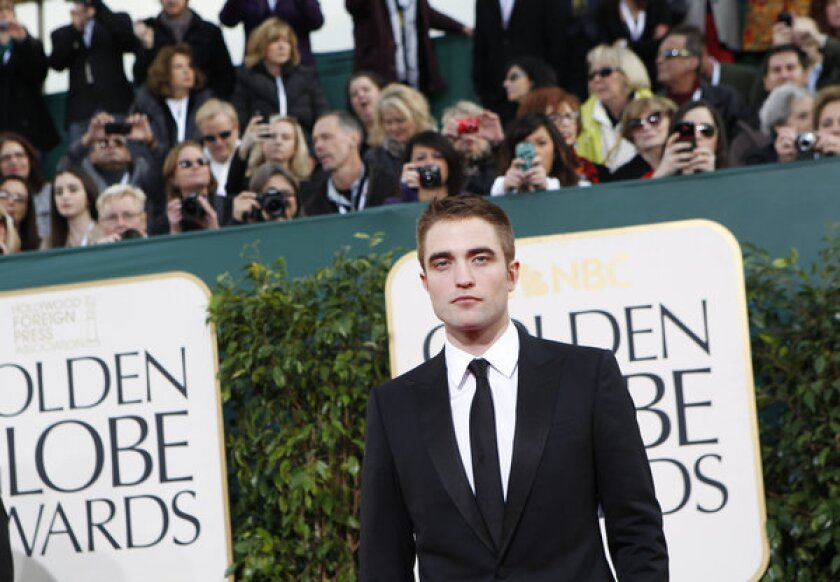Robert Pattinson arrives for the 70th Annual Golden Globe Awards show at the Beverly Hilton Hotel.