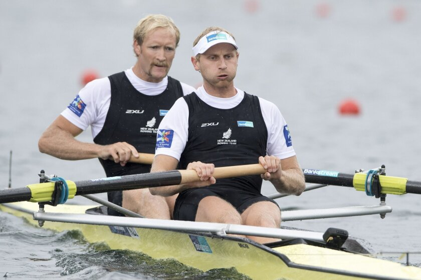 FILE - In this May 29, 2016, file photo, Hamish Bond and Eric Murray, from right, from New Zealand,  compete at the Men's Pair Final race at the Rowing World Cup on Lake Rotsee in Lucerne, Switzerland. When Murray and Bond jump into their boat in Rio, people won't be asking whether they're going to