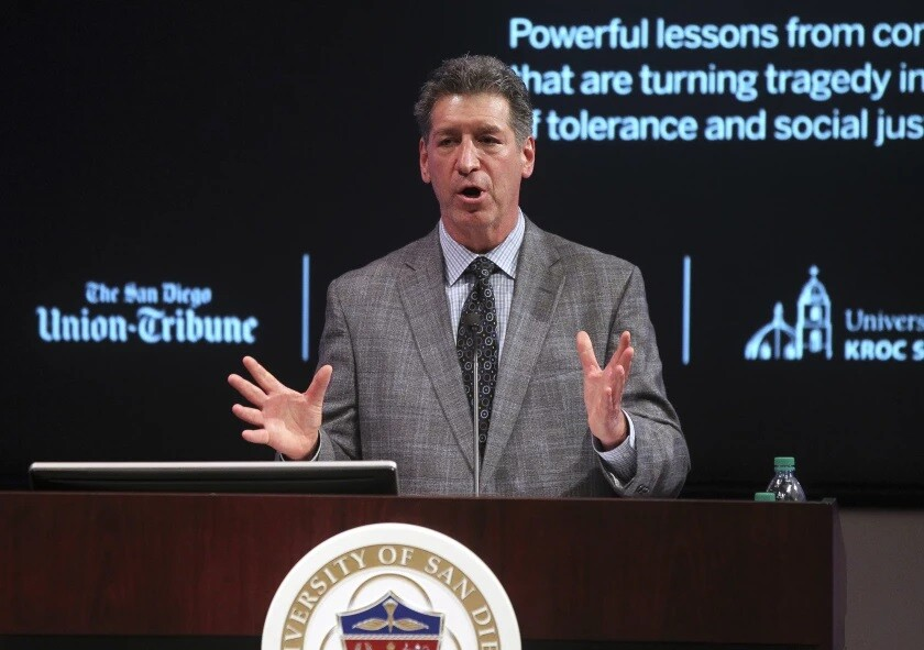 Steven Dinkin, president of the Conflict Resolution Center, speaks during a 2019 event in San Diego.