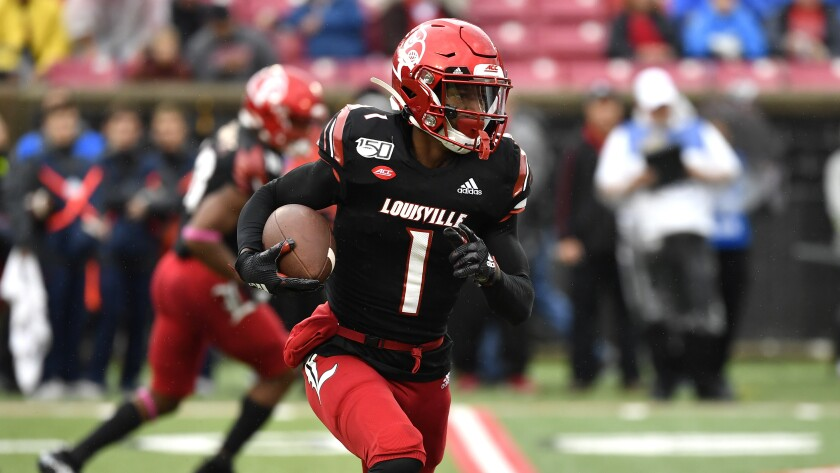 Louisville wide receiver Tutu Atwell runs with the ball during a game.