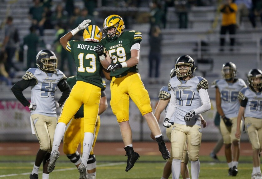 Edison High left tackle Grant Conaway (59) celebrates with Cole Koffler after Koffler scored a touchdown against Canyon in a nonleague game at Cap Sheue Field on Aug. 30, 2018.
