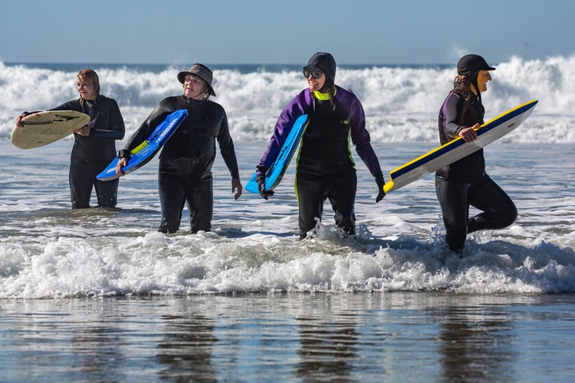Members of the Newcomers Club of San Dieguito's Boogie Board club at Fletcher Cove in Solana Beach on Monday.