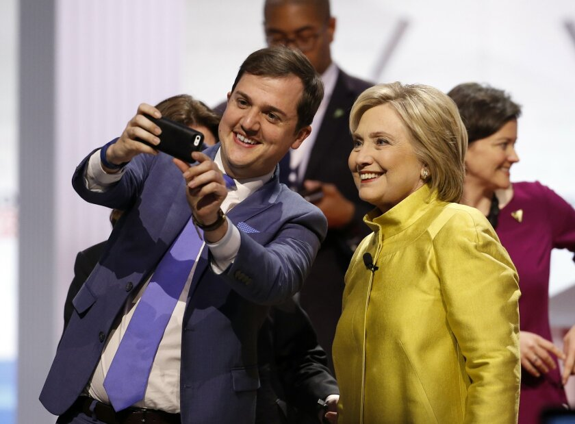 Democratic presidential candidate, Hillary Clinton poses for a picture with a supporter after a Democratic presidential primary debate at the University of Wisconsin-Milwaukee, Thursday, Feb. 11, 2016, in Milwaukee. (AP Photo/Morry Gash)