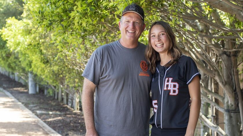 Huntington Beach High's head coach Jeff Forsberg and Kelli Kufta pose for a photo together.