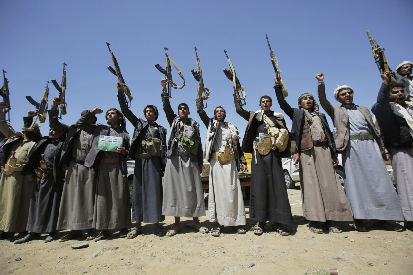 Shiite Houthi tribesmen hold their weapons as they chant slogans during a tribal gathering in Sana, Yemen, in 2019.