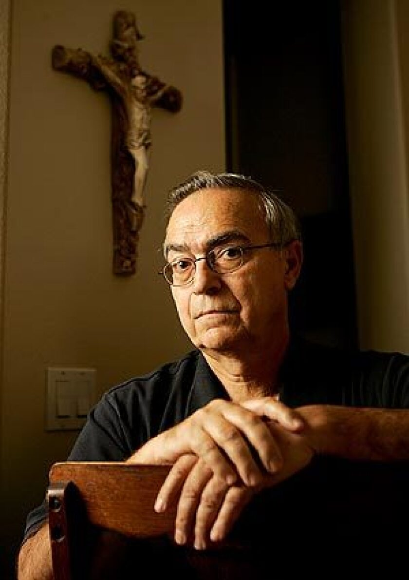 Donald Ashman, seen at his Thousand Oaks home, is an Anglican priest who was a passenger on the Metrolink train that crashed Friday in Chatsworth. Though still in a daze from the collision, he administered last rites to people who died at the scene.