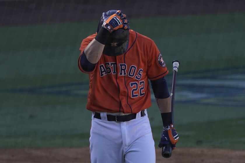 Houston Astros' Josh Reddick reacts after striking out against the Oakland Athletics during the eighth inning of Game 3 of a baseball American League Division Series in Los Angeles, Wednesday, Oct. 7, 2020. (AP Photo/Ashley Landis)