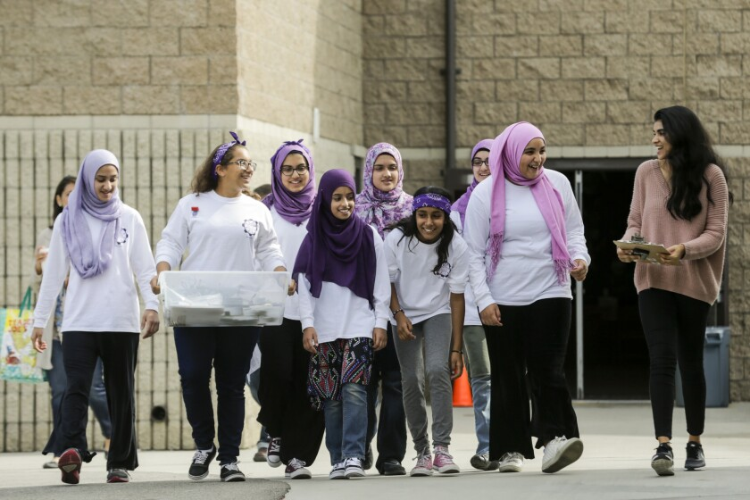The FemSTEM team walks out of the gym after competing in the First Lego League robotics competition.
