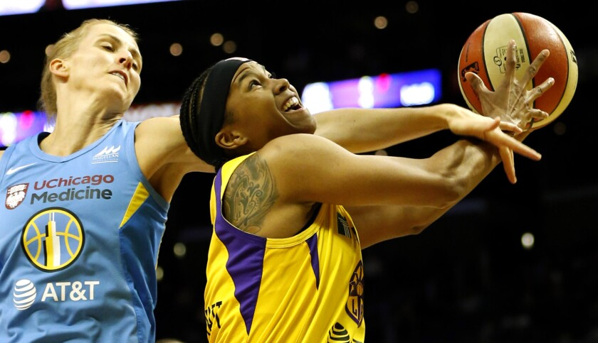 Sparks forward Tierra Ruffin-Pratt is fouled on a layup by Sky guard Allie Quigley during the second half Sunday.
