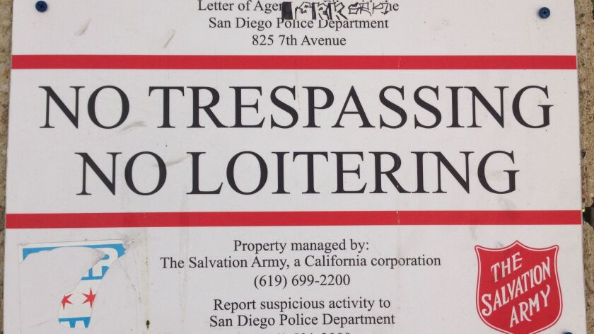 A sign at the downtown Salvation Army complex warns against loitering.