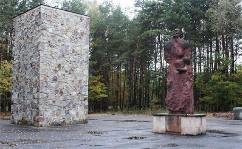 FILE - In this photo taken Oct. 11, 2003, a monument commemorating the estimated 250,000 people who were killed at the Nazi death camp of Sobibor is seen on the former camp grounds in Sobibor, eastern Poland. John Demjanjuk goes on trial Monday, Nov. 30, 2009 on charges of being an accessory to the