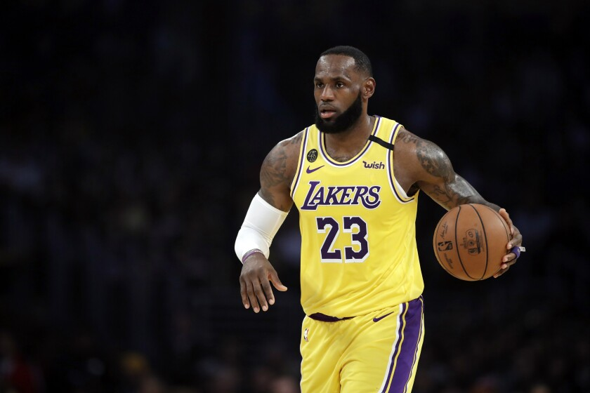Lakers' LeBron James dribbles during the first half against the Brooklyn Nets at Staples Center on March 10.