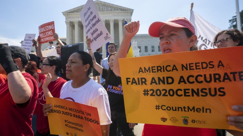 Demonstrators gather at the Supreme Court as the justices finish the term with key decisions on gerr