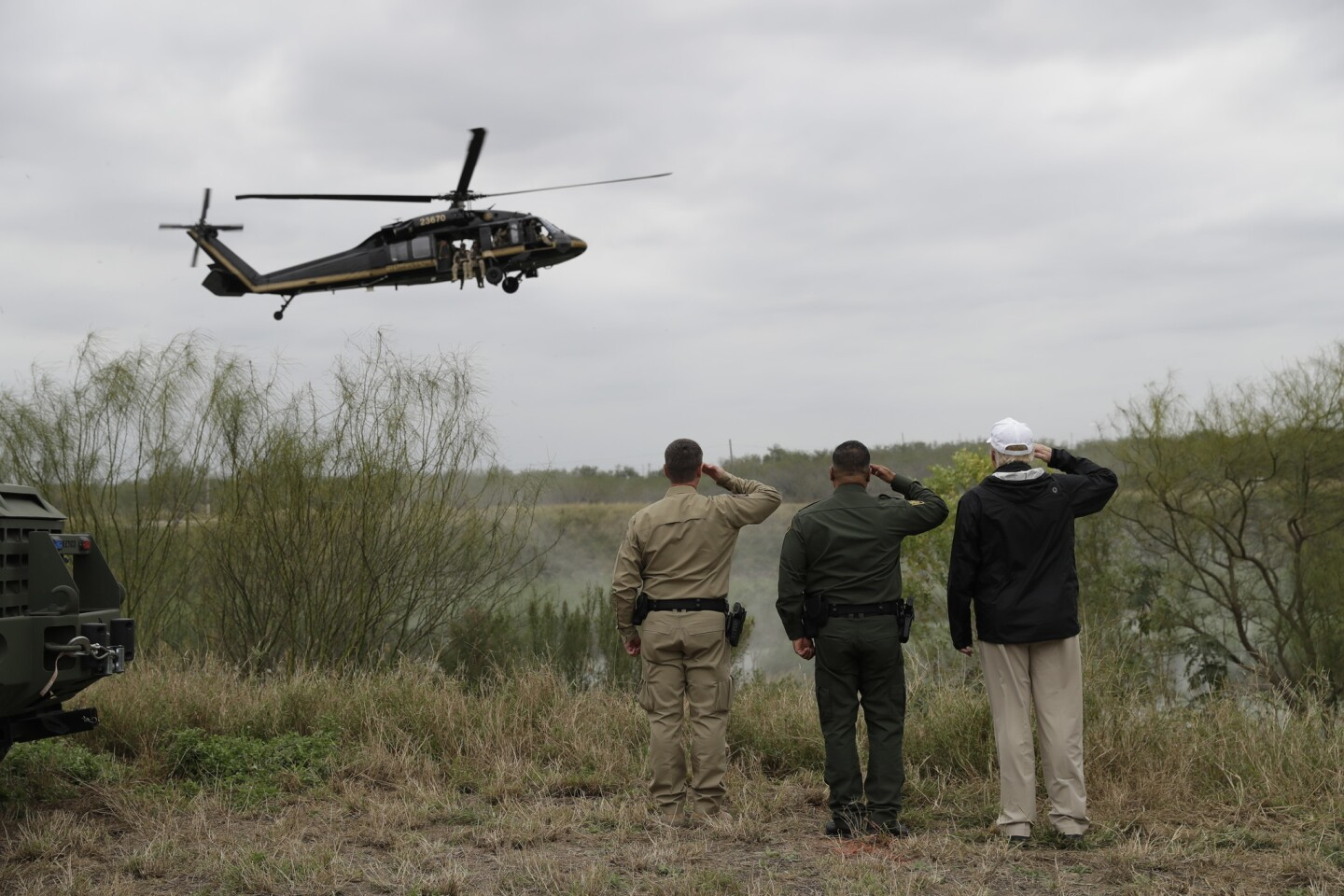 President Trump salutes a U.S. Customs and Border Protection helicopter as he tours the U.S.-Mexico border Jan. 10 in McAllen, Texas.