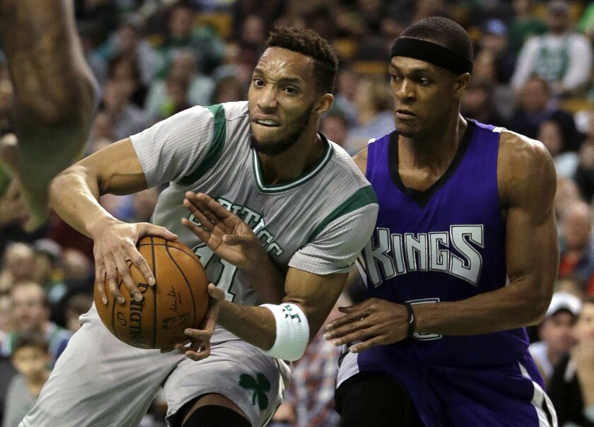 Boston Celtics guard Evan Turner, left, tries to drive to the basket past Sacramento Kings guard Rajon Rondo, right, in the second quarter of an NBA basketball game, Sunday, Feb. 7, 2016, in Boston. (AP Photo/Steven Senne)
