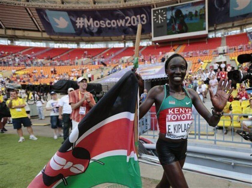Kenya's Edna Ngeringwony Kiplagat celebrates after winning the women's marathon final at the World Athletics Championships in the Luzhniki stadium in Moscow, Russia, Saturday, Aug. 10, 2013. (AP Photo/Ivan Sekretarev) .