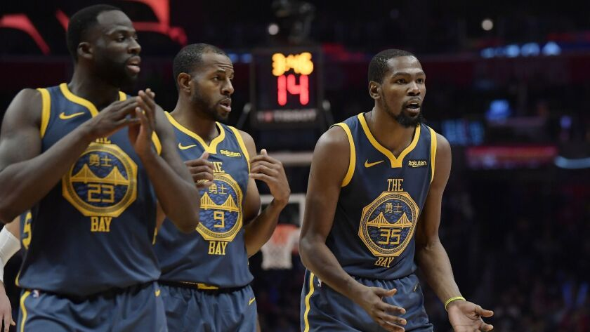 Golden State Warriors forward Kevin Durant, right, reacts as he fouls out of the game against the Clippers.