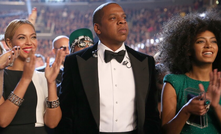 Beyonce, left, Jay Z and Solange Knowles say they've kissed and made up after a May 5 fight captured on surveillance video. The scene in the elevator went public Monday.