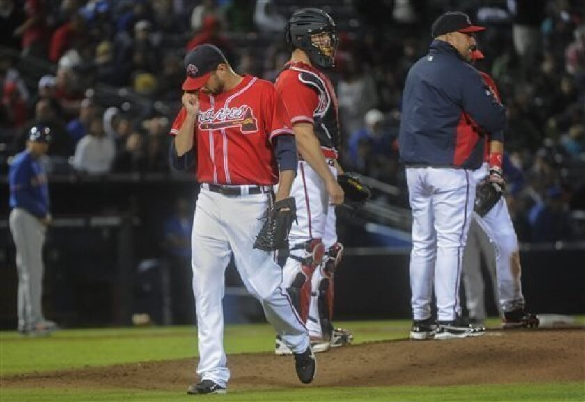 Atlanta Braves relief pitcher Jordan Walden comes off the field after allowing the New York Mets the go ahead during the tenth inning of a baseball game, Friday, May 3, 2013, in Atlanta. (AP Photo/John Amis)