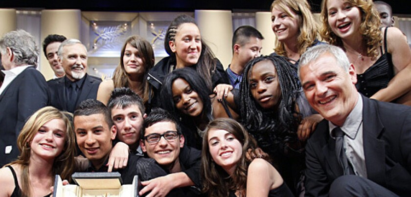 """French director Laurent Cantet (right) poses with his cast after winning the Palme d'Or award for his film """"Entre Les Murs (The Class)."""""""