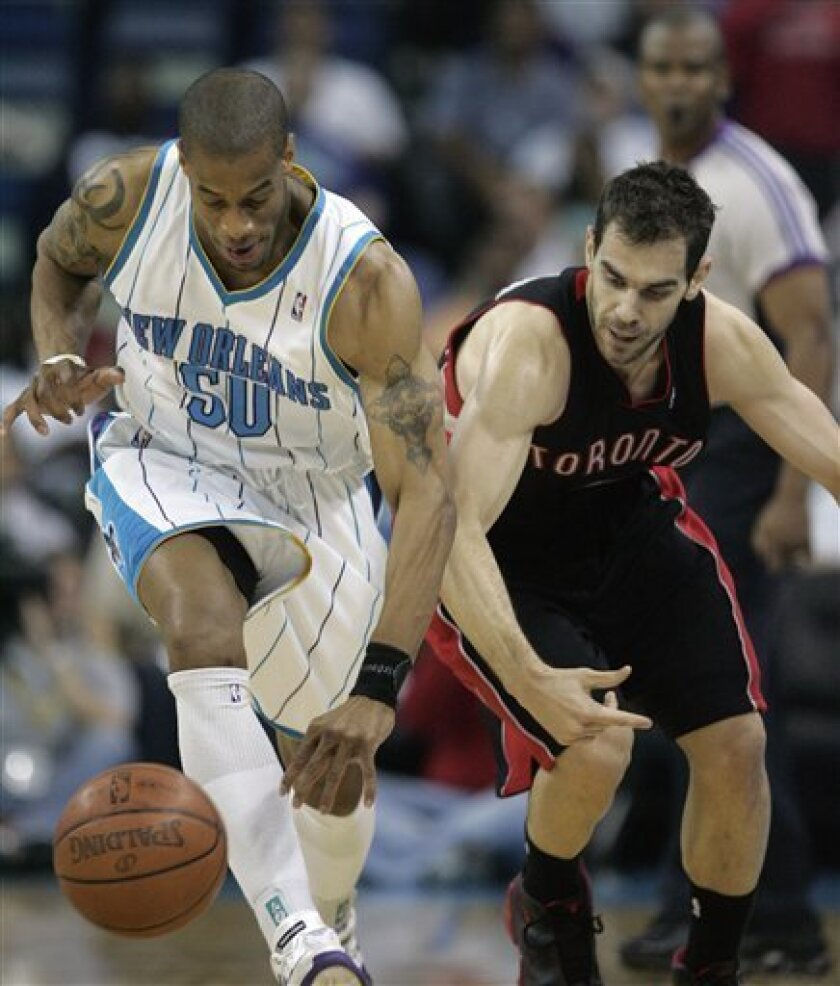 New Orleans Hornets Antonio Daniels (50) steals the ball from ]Toronto Raptors guard Jose Calderon (8), of Spain, in the first half of their NBA basketball game in New Orleans, Friday, Feb. 6, 2009. (AP Photo/Bill Haber)