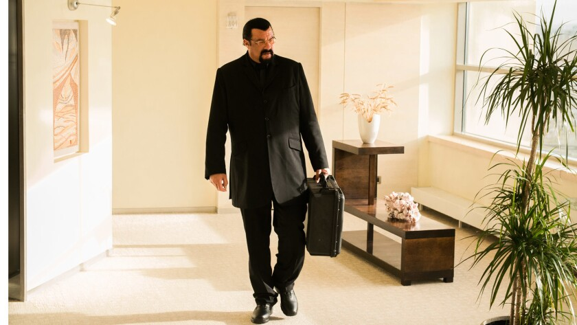 "Steven Seagal in the movie ""Contract to Kill."""