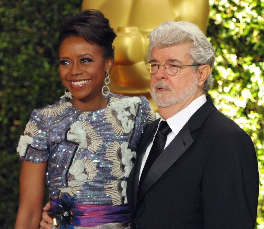 Filmmaker George Lucas and his wife, investment executive Mellody Hobson, attend an awards ceremony in Los Angeles in November; they have given $2million for an arts center for a Chicago private elementary and high school.