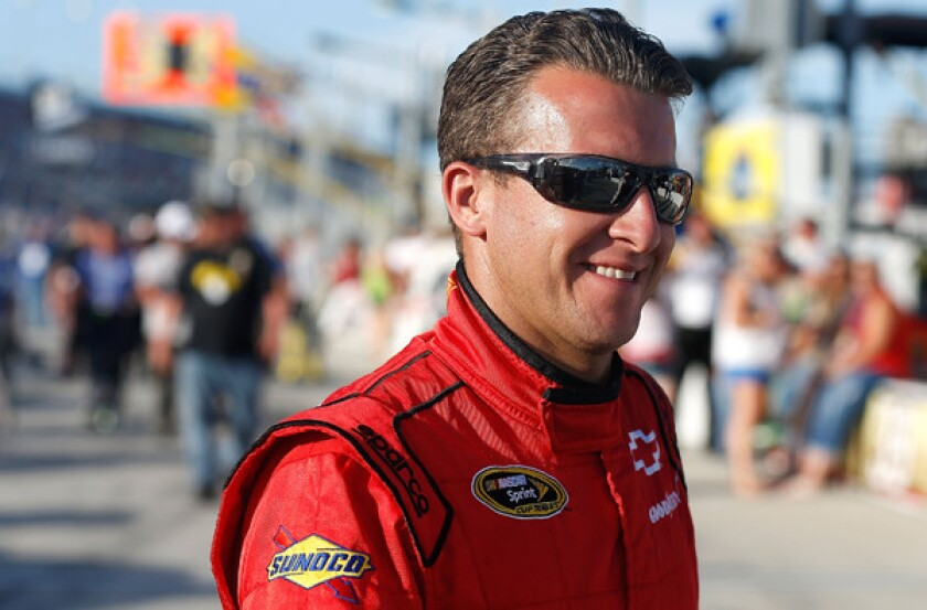 NASCAR driver A.J. Allmendinger heads to his Sprint Cup car before the start of the Coke Zero 400 at Daytona International Speedway earlier this summer.