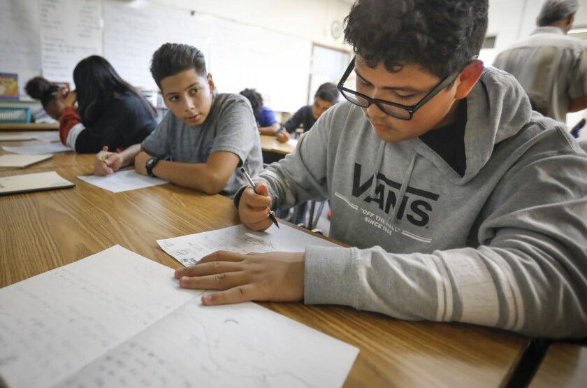 Domanick Castro and Jonnie Gallardo did classwork at Wilson Middle School in 2019.