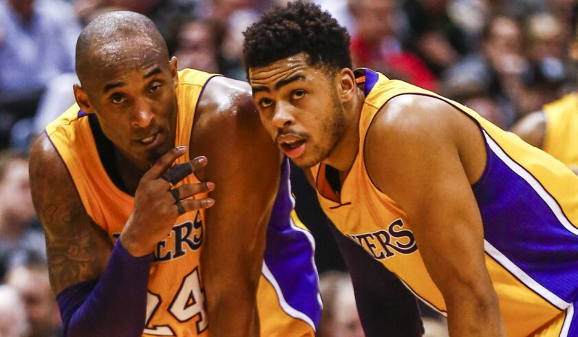 Kobe Bryant, left, talks with Lakers rookie D'Angelo Russell during a game against Milwaukee on Feb. 22.