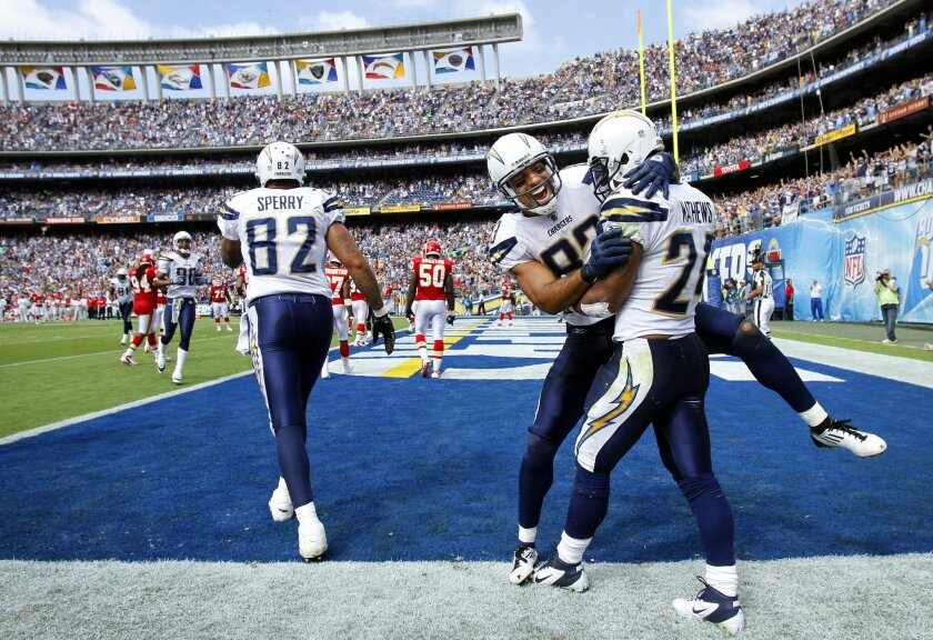 Chargers Kory Sperry, left, Vincent Jackson and Ryan Mathews celebrate Mathew's touchdown in the 3rd quarter.
